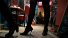 In this photo taken Sunday, Nov. 30, 2014 a woman wears high heels in a restaurant in Paris. (AP Photo/Francois Mori)