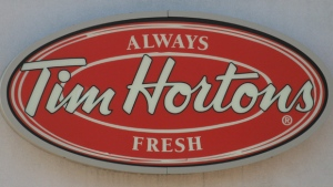 A Tim Hortons logo is shown at an outlet in Oakville, Ont., on Aug.25, 2010. (THE CANADIAN PRESS / Richard Buchan)