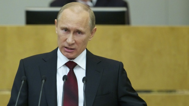 Russian Prime Minister and President-elect Vladimir Putin speaks to the State Duma, Russian Parliament's lower house, in Moscow, Russia, Wednesday, April 11, 2012. (AP Photo/Ivan Sekretarev)