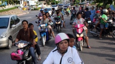 Residents flee on motorcycles to high ground after receiving warning signals after an earthquake off Indonesia's western coast shook hit Phuket, Wednesday, April 11, 2012. (AP)
