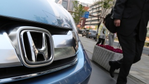 A man walks past a Honda on display at Honda Motor Co. headquarters in Tokyo on April 25, 2014. (AP / Koji Sasahara)