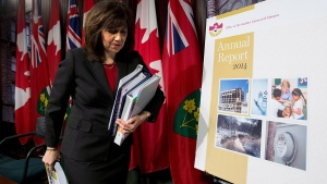 Auditor General Bonnie Lysyk leaves a news conference after delivering her 2014 report in Toronto on Tuesday, Dec. 9, 2014. (Nathan Denette  / THE CANADIAN PRESS)