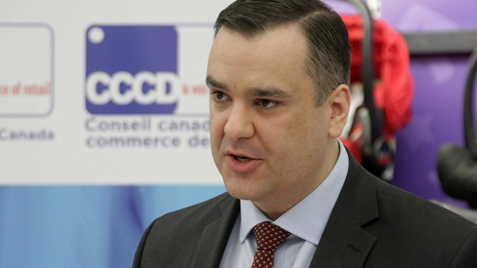 Industry Minister James Moore announces legislation aimed at ensuring prices in Canada are not unfairly higher than those in the U.S., in Toronto, on Tuesday Dec. 9, 2014. (Colin Perkel / THE CANADIAN PRESS)