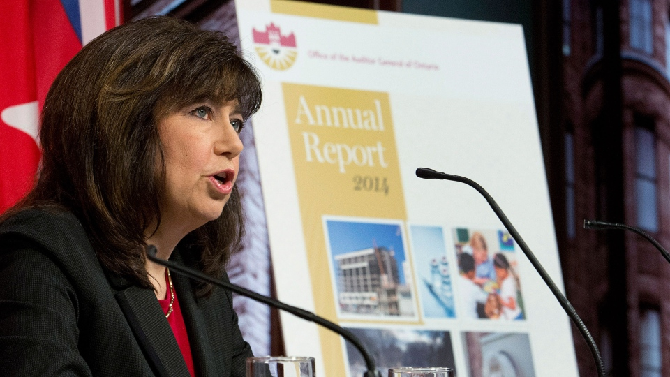 Auditor General Bonnie Lysyk delivers her 2014 report during a press conference in Toronto on Tuesday, December 9, 2014. (Nathan Denette  / THE CANADIAN PRESS)
