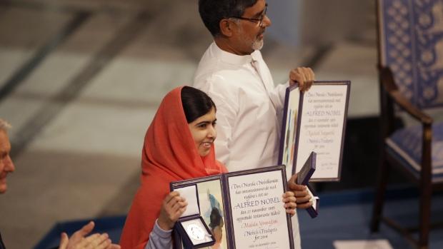 Malala Holding Nobel Peace Prize
