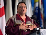Perry Bellegarde, chief of the Little Black Bear First Nation in Saskatchewan, addresses the audience as native leaders from across Canada attend the Assembly of First Nations' 35th annual general meeting in Halifax on Thursday, July 17, 2014. (The Canadian Press/Andrew Vaughan)