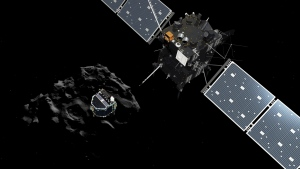 The image released by the European Space Agency ESA on Nov. 12, 2014 shows an artist's rendering  depicting lander Philae separating from the Rosetta mother spaceship and descending to the surface of comet 67P/Churyumov-Gerasimenko. (AP / ESA / ATG Medialab)