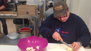 Farrell Lavallee cuts vegetables at the Lighthouse Mission in Winnipeg.