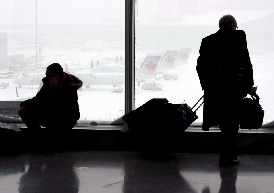 Passengers wait at Pearson Airport in Toronto on Friday February 8, 2013. (Frank Gunn/THE CANADIAN PRESS)