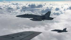 Royal Canadian Air Force CF-18 Hornets over Iraq, on Oct. 30, 2014. (THE CANADIAN PRESS / HO-U.S. Air Force Photo by Staff Sgt. Perry Aston)