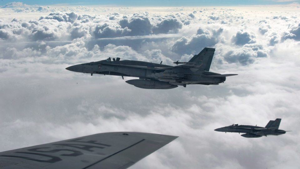 Royal Canadian Air Force CF-18 Hornets over Iraq on Oct. 30, 2014. (HO-U.S. Air Force Photo by Staff Sgt. Perry Aston/The Canadian Press)