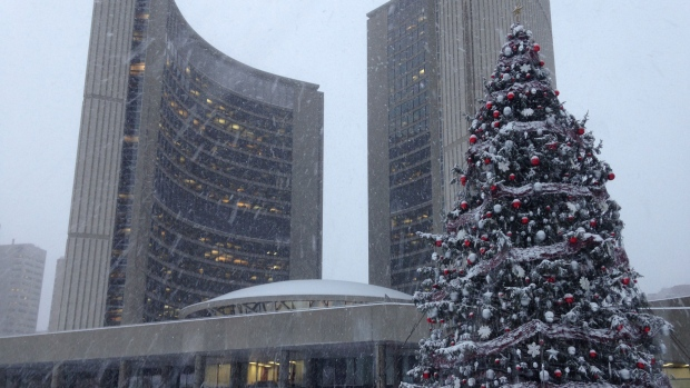 A low-pressure storm system moved across southern Ontario overnight, dumping 10 to 15 centimetres of snow in the area. <br><br> Snow falls outside of Toronto City Hall on Thursday, Dec. 11, 2014. (George Stamou / CTV News)