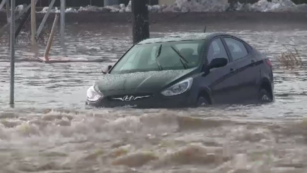 Jones Lake spilled out over Main Street in Moncton on Thursday, trapping this car in water.