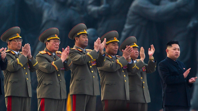 North Korean leader Kim Jong Un, far right, applauds with senior military officials at an unveiling ceremony for statues of the late leaders Kim Il Sung and Kim Jong Il in Pyongyang, North Korea, Friday, April 13, 2012. (AP / David Guttenfelder)