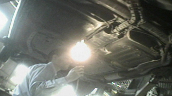 A mechanic inspects a vehicle at Haarak Auto Collision Service and Sale in Mississauga. According to the mechanic, the car was fine, except for a tire, some wheel nuts and a brake job. But when the car was on the lift Haarak's, the APA expert saw obvious things wrong with vehicle.