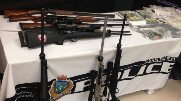 Police showed guns seized as part of Project Distress on Dec. 11, 2014 in Winnipeg, Man.