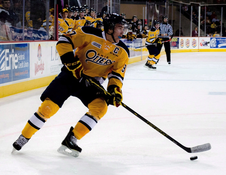 Erie Otters' Connor McDavid controls the puck during an OHL game against the Sarnia Sting on Oct. 4, 2014. (Erie Otters / Matt Mead / THE CANADIAN PRESS)