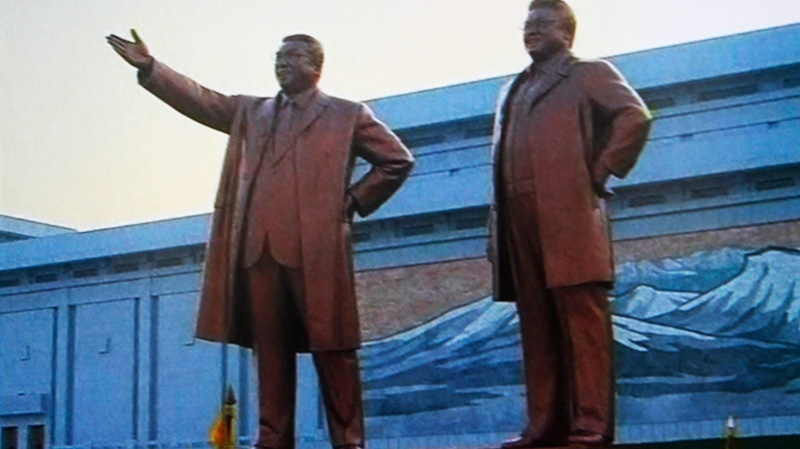 The statues of late North Korean leaders, Kim Il Sung, left, and his son, Kim Jong Il, are unveiled in Pyongyang, North Korea, Friday, April 13, 2012. (KRT via AP video)