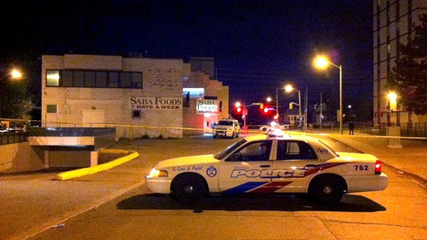 A Toronto police vehicle is seen at the scene of a shooting at 251 Woolner Avenue, Thursday, April 12, 2012. (Spencer Gallichan-Lowe / CTV News)