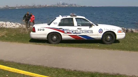police car is scene in this picture after a woman was pulled from Lake Ontario on Friday, April 13, 2012.