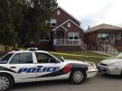 Windsor police investigate a homicide at 1566 Benjamin Ave in Windsor, Ont., Thursday, Dec.11, 2014. (Rich Garton / CTV Windsor)