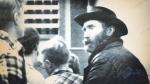 'Mountain man' Don Nichols, right, being taken into custody near Bozeman, Mont. on Dec. 14, 1984. (AP / Bozeman Chronicle)