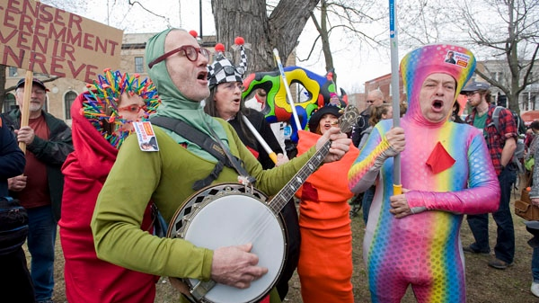Colourful protesters opposing the rise in tuition fees demonstrate in Montreal Saturday, April 14, 2012. (Graham Hughes / THE CANADIAN PRESS)