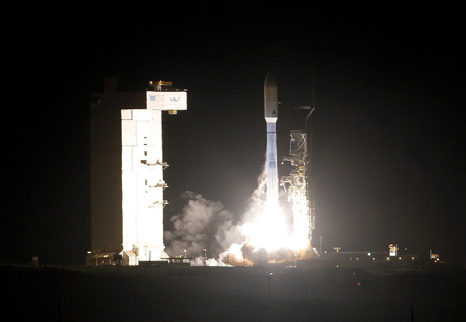 United Launch Alliance Atlas V rocket carrying a National Reconnaissance Office satellite launches from Space Launch Complex-3 at Vandenberg Air Force Base Friday, Dec. 12., 2014. (AP Photo)