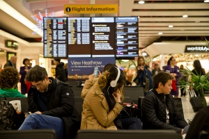 Passengers wait at Heathrow Airport in London, Friday, Dec. 12, 2014. London's airspace was closed today due to what authorities say was a computer failure at one of Britain's two air traffic control centres. (AP Photo/Vadim Ghirda)