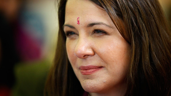 Wildrose Leader Danielle Smith, centre, makes a campaign stop at a Hindu temple in Calgary, Alta., Sunday, April 15, 2012. (Jeff McIntosh / THE CANADIAN PRESS)