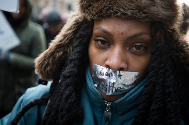 Demonstrators march in New York, Saturday, Dec. 13, 2014. (AP / John Minchillo)