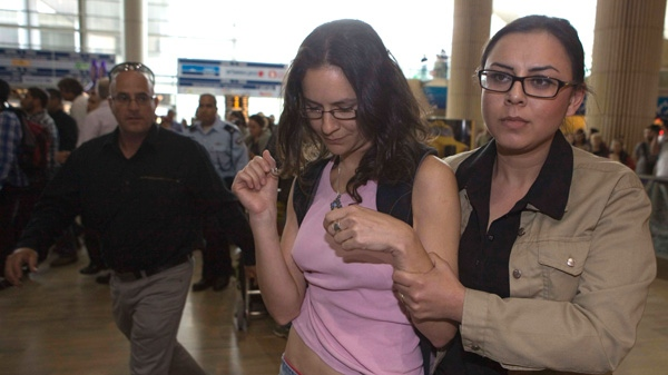 An Israeli left-wing activists is detained at Ben Gurion Airport near Tel Aviv, Israel, Sunday, April 15, 2012. (AP / Dan Balilty)