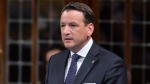 Minister of Natural Resources Greg Rickford responds to a question during Question Period in the House of Commons on Parliament Hill in Ottawa, Wednesday June 18, 2014 . THE CANADIAN PRESS/Adrian Wyld