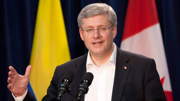 Prime Minister Stephen Harper speaks with the media during a news conference following the closing of the Summit of the Americas in Cartagena, Colombia, Sunday, April 15, 2012. (Adrian Wyld / THE CANADIAN PRESS)