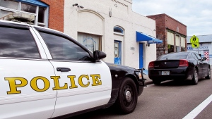 Police cars are parked in front of the Waldo Police Department in Waldo, Fla., Thursday Oct. 2, 2014. (AP / Jason Dearen)