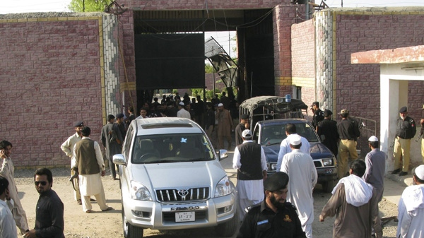 "Pakistani security officials visit the central jail in Bannu, 170 kilometer (106 miles) south of Peshawar, Pakistan on Sunday, April 15, 2012. Taliban militants battled their way into the prison on Sunday, freeing close to 400 prisoners, including at least 20 described by police as ""very dangerous"" insurgents, authorities and the militants said. (AP Photo/Ijaz Muhammad)"