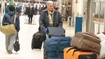 It is estimated that about 60,000 people will go through the security screening at Toronto's Pearson International Airport in December, up from the usual 40,000.