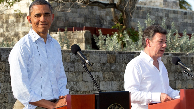 U.S. President Barack Obama, left, and Colombian President Juan Manuel Santos attend a joint news conference during the 6th Summit of the Americas in Cartagena, Colombia, Sunday, April 15, 2012. (AP / Carolyn Kaster)
