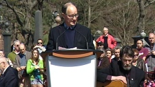 Andrew Murphy, chairman of the Titanic 100 Society, speaks at a memorial service at Fairview Lawn Cemetery to mark the 100th anniversary of the sinking of RMS Titanic in Halifax on Sunday, April 15, 2012.