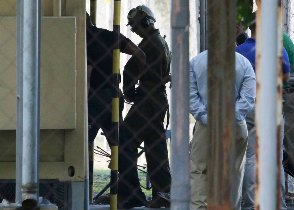 U.S. Marine Pfc Joseph Scott Pemberton, a suspect in the gruesome killing of a transgender Filipino woman, is escorted to his detention as he arrives inside the compound of the Camp Aguinaldo military headquarters in suburban Quezon city, north of Manila, Philippines, Wednesday, Oct. 22, 2014. (AP / Aaron Favila)
