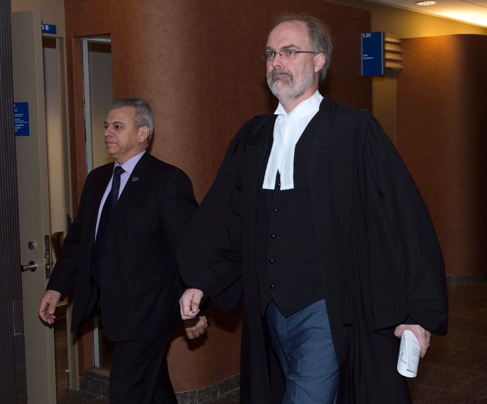 Crown prosecutor Louis Bouthillier, right, waits for the start of the judge's instruction to the jury before deliberations begin at the murder trial for Luka Rocco Magnotta in Montreal on Monday, Dec. 15, 2014. (Ryan Remiorz / THE CANADIAN PRESS)