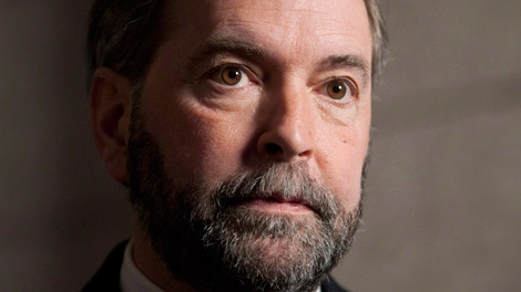 NDP leader Thomas Mulcair says he is keeping his beard. Mulcair speaks with the media following the party caucus meeting on Parliament Hill in Ottawa, Wednesday April 4, 2012. (THE CANADIAN PRESS/Adrian Wyld)