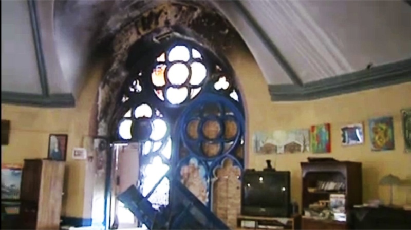 This stained glass window at the St. James United was damaged by fire in March.