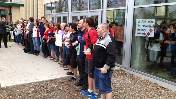 Gatineau university teachers, students barricade themselves inside school in protest.