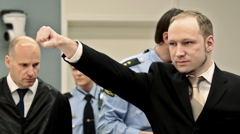 Accused Norwegian Anders Behring Breivik gestures as he arrives at the courtroom, Monday, April 16, 2012 in Oslo, Norway. (AP Photo/Hakon Mosvold Larsen, Pool)