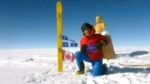 Frederic Dion of Quebec, 37, arrives by kite-ski to the 'South Pole of inaccessibility', Monday, Dec. 15, 2014.
