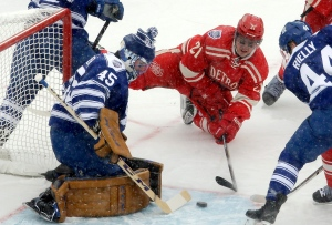 In this file photo, Toronto Maple Leafs goalie Jonathan Bernier (45) blocks a shot by Detroit Red Wings left wing Tomas Tatar (21), of the Czech Republic, during the first period of the Winter Classic outdoor NHL hockey game at Michigan Stadium in Ann Arbor, Mich., Wednesday, Jan. 1, 2014. (AP Photo/Carlos Osorio)
