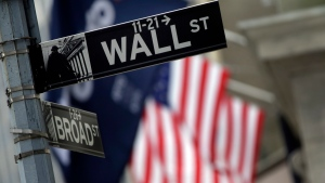 A Wall Street sign adjacent to the New York Stock Exchange, Thursday, Oct. 2, 2014. (Richard Drew/AP)