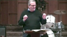 Allan Hunsperger, a pastor who is running as a candidate for the Wildrose party, is seen in this image captured from video.