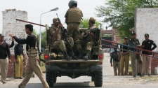 Pakistani army troops enter the central jail in Bannu, Pakistan